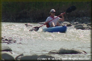Shannon Theriot kayaking a small riffle on the Rio Grande