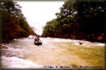 Marc McCord running the rapids on a flooded Blanco River
