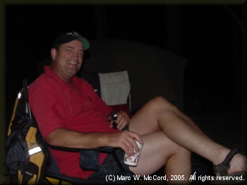 Steve Crowe relaxing at a riverside campsite on the LMF