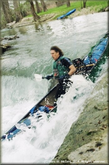 Marc McCord running the waterfall at 300 cfs