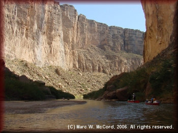 Majestic canyon walls rise from the river to awe paddlers