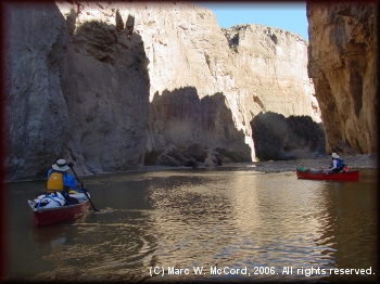 Gary Tupa (left) and Tom Taylor paddle into the canyon