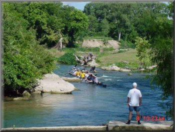 6-man boat approaching Cottonseed Rapid